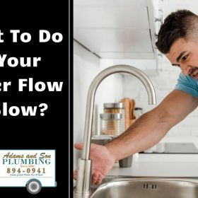 a man looking at a faucet with slow water flow